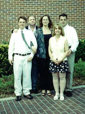 My dad's chin was held high and his arm was around me on my college graduation day from the University of Florida in 2000. Also pictured is my brother, far right, my mom, second from right, and my sister-in-law. My dad died from melanoma in January 2004.