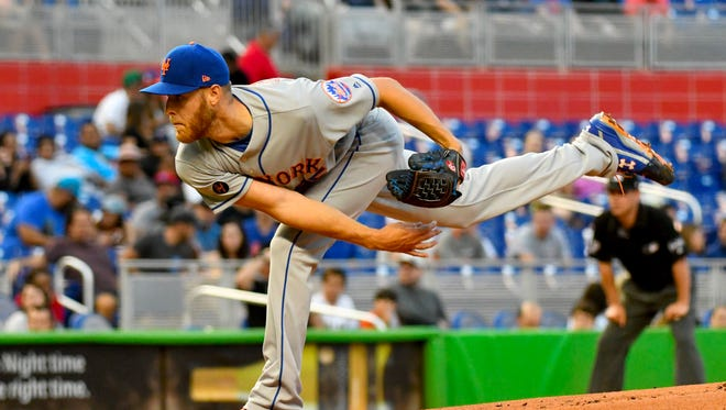 New York starting pitcher Zack Wheeler (45) delivers a pitch in the first inning against the Miami Marlins during a MLB game at Marlins Park.