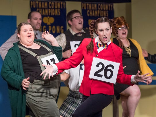 Gracie Dodson, center, and others rehearse for Encore