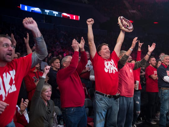 Hoses' fans cheer during the Guns and Hoses fight night