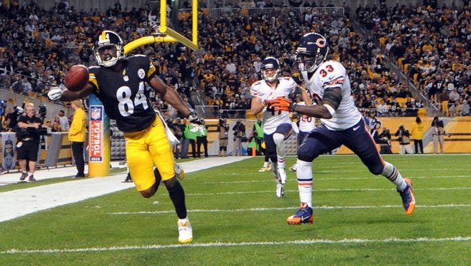 Steelers wide receiver Antonio Brown miraculously hauled in this touchdown pass as one of his 10 receptions in Week 3 against Chicago.