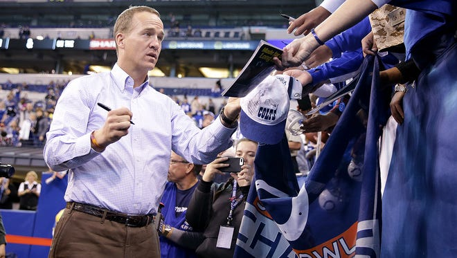Indianapolis Colts former quarterback Peyton Manning signs autographs for fans before the Colts game against the Tennessee Titans. The Indianapolis Colts host the Tennessee Titans in their NFL football game Sunday, November 20, 206, afternoon at Lucas Oil Stadium