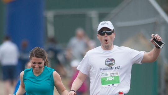 A couple finishes the Montgomery Half Marathon on Saturday,