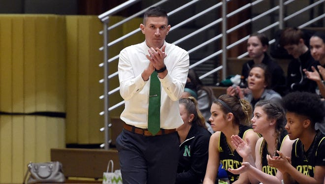 North head coach Tyler Choate applauds his teamÕs effort during the first quarter of the SIAC girlsÕ basketball tournament against Castle at Castle High School Friday.