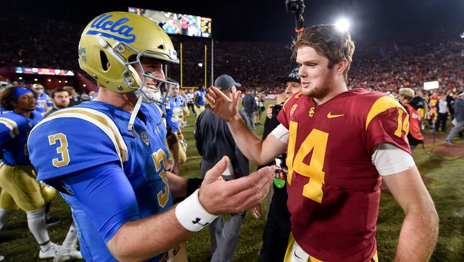 Southern California Trojans quarterback Sam Darnold (right) and UCLA Bruins quarterback Josh Rosen (3) shake hands after their game at Los Angeles Memorial Coliseum.