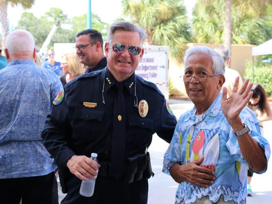 Marco Police Chief Schettino with Jay Santiago. On Monday, Aug. 28, 2017, Marco Island celebrated 20 years of being a city.