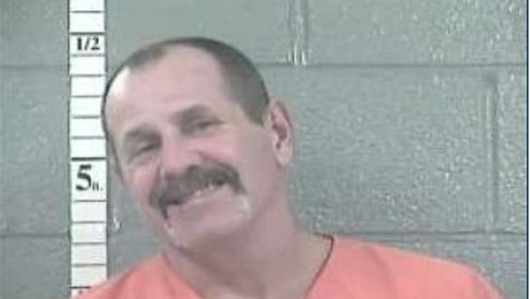 Victor Kustes, 53, was arrested at the home and faces