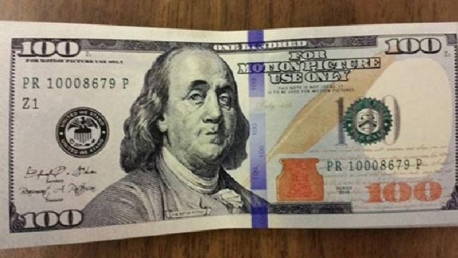 """This fake $100 bill is marked """"for motion picture use only"""" and was found at Outback in Brighton Township on the weekend."""