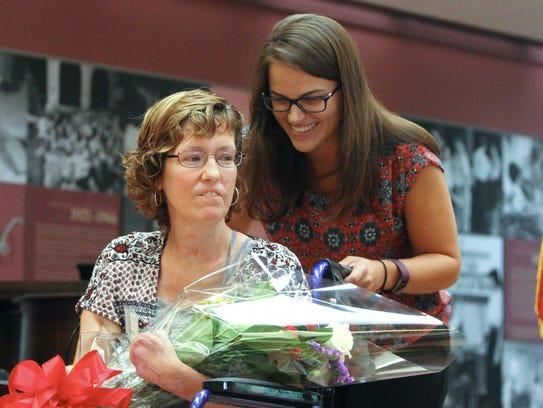 Honoree Linda Wells with therapist Alyssa Santoru during