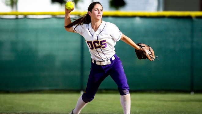 Opelousas second baseman Madison Nicholas prepares to throw to first base for the out against Sacred Heart of Ville Platte.