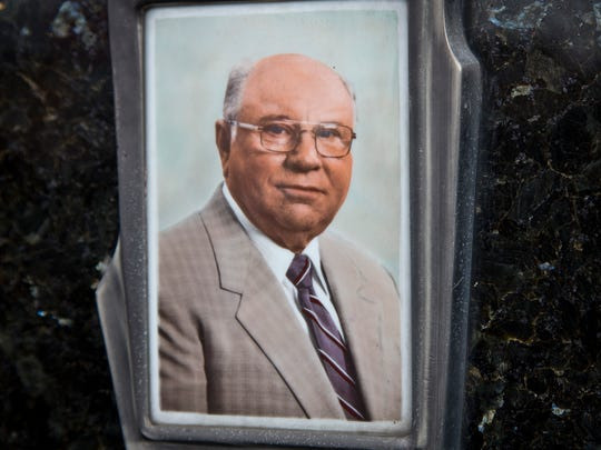 This July 28, 2014, photo shows Jakob Denzinger's portrait on the tombstone of his empty grave in Cepin eastern Croatia.