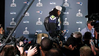 Jan 28, 2015; Phoenix, AZ, USA; Seattle Seahawks running back Marshawn Lynch (24) walks away from reporters during the Seattle Seahawks press conference at Arizona Grand.