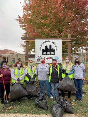 Staff and volunteers of VOICES of Stephenson County collect trash along Pleasant Street on Tuesday, Oct. 20, 2020, in front of the Boys and Girls Club in Freeport.