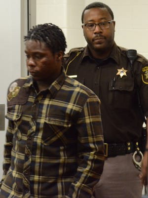 James Hatfield enters the courtroom Friday before a jury found him guilty of manslaughter.