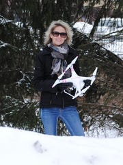 Randolph resident and drone enthusiast Jody Johnson with her camera-equipped 'Phantom' model by DJI.