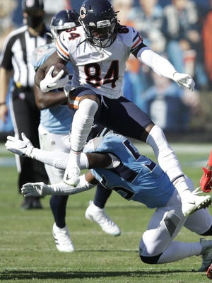 Bears wide receiver Cordarrelle Patterson (84) leaps over Titans inside linebacker Jayon Brown (55) on Sunday in Nashville, Tenn.