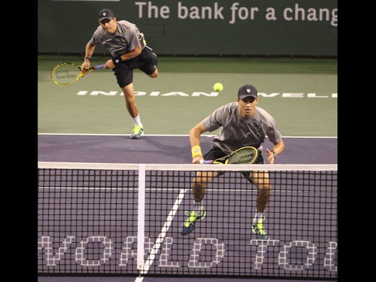 The Bryan brothers serve forthe BNP Paribas Open championship title against Alexander Peya, of Austria, right,  and Bruno Soares, of Brazil on Saturday, March 15, 2014 in Indian Wells, CA