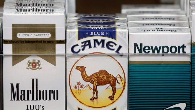 Packs of cigarettes are on display at a newsstand in Chicago. Illinois' $1-per-pack cigarette tax increase went into effect in June 2012.