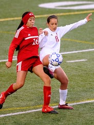 Cooper's Judith Macias (18) steals the ball away from