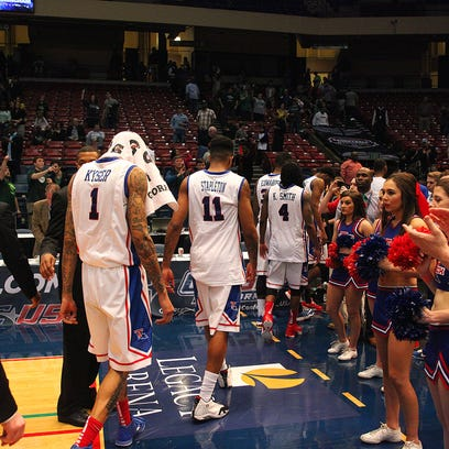 Louisiana Tech players walk off the court in disappointment