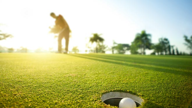 Downhill putts can be challenging because they roll faster than a normal putt.