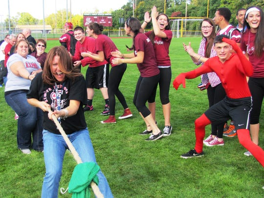 A team of Elmira High School faculty bested the junior class to win the tug-of-war competition at Friday's pep rally.