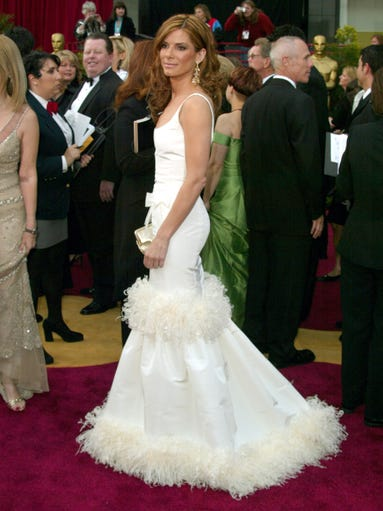 Glamour, talent and a penchant for being the nicest gal on the block? That's Sandra Bullock in a nutshell. But her signature style has evolved since she stepped into the spotlight: In 2004, a spray-tanned, golden-haired Bullock wore a feather-encased Oscar de la Renta gown to the Academy Awards. Her Oscars style would change dramatically over the next decade.