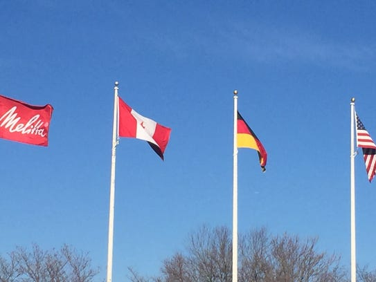 A Melitta company banner flies with the flags of Canada,