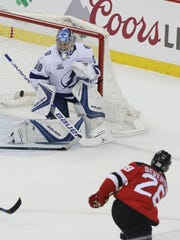 Tampa Bay goaltender Andrei Vasilevskiy makes a second