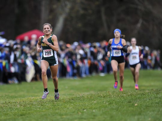 North Hunterdon's Chloe Gonzalez races to the finish line at the Cross Country Meet of Champions at Holmdel Park in Holmdel on Nov. 18, 2017.