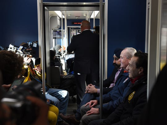 Phil Murphy visits Hoboken on Saturday January 13, 2018. Murphy speaks with the press while riding the light rail to Jersey City.