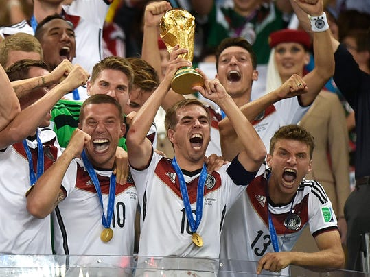 Germany's Philipp Lahm (16) raises the trophy after the World Cup final soccer match between Germany and Argentina at the Maracana Stadium in Rio de Janeiro, Brazil, Sunday, July 13, 2014. Germany won the match 1-0. (AP Photo/Martin Meissner)