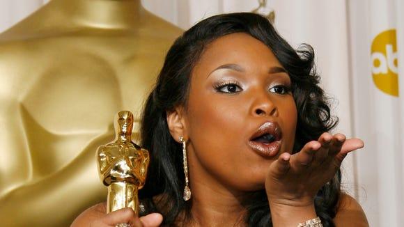 Jennifer Hudson poses with the Oscar she won for best