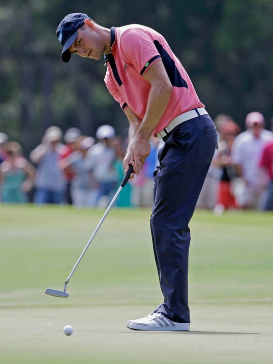 Martin Kaymer of Germany, watches his putt on the seventh green during the final round of The Players championship golf tournament at TPC Sawgrass, Sunday, May 11, 2014 in Ponte Vedra Beach, Fla. (AP Photo/Lynne Sladky)