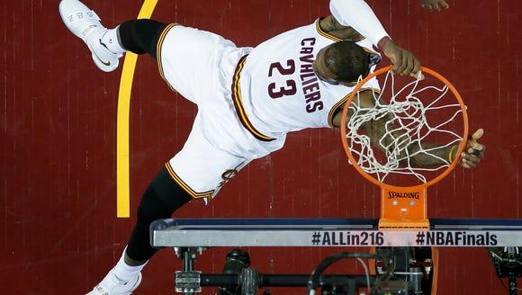 Cleveland Cavaliers forward LeBron James (23) dunks