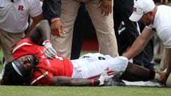 Rutgers' Janarion Grant is down on the field and in