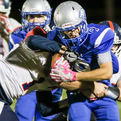 Carroll's Quinton Veach fights for extra yards against