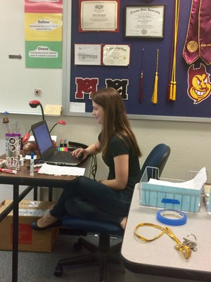 Carly Blodgett, an English teacher at McClintock High School in Tempe, keeps the door to her classroom locked to keep her students safe.