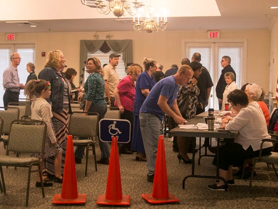 A crowd of voters wait in line at Normandie Ridge Senior