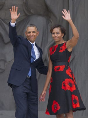 President Obama and first lady Michelle Obama wave at Lincoln Memorial for 50th anniversary of the March on Washington.