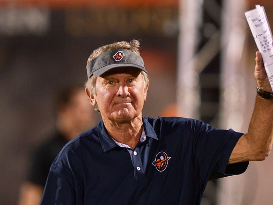 Orlando Apollos head coach Steve Spurrier waves to the crowd as he enters the field before kick-off against the Memphis Express.