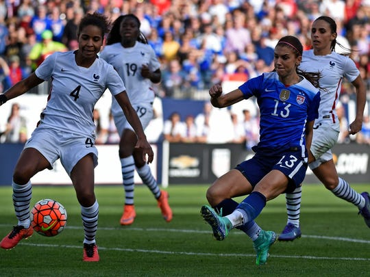 Alex Morgan, 13, scores the winning goal during the SheBelieves Cup game versus France at Nissan Stadium in 2016. The USWNT returns to Nashville to face England on Saturday.
