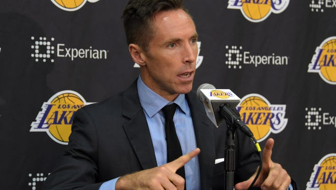 Lakers guard Steve Nash addresses the media at the news conference to announce his retirement.