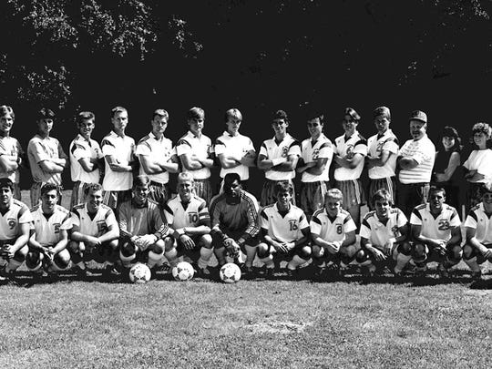 The University of Vermont men's soccer team poses for a team picture in 1989.