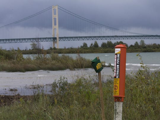 A marker on the north shore of the Straits of Mackinac indicates where a pipeline enters the water in St. Ignace, Mich. Just west of the iconic bridge are two oil pipelines laid in 1953 that span the bottom of the Straits, the 5 mile-wide strip of water separating Lakes Michigan and Huron that is whipsawed by currents unlike anywhere else in the Great Lakes.