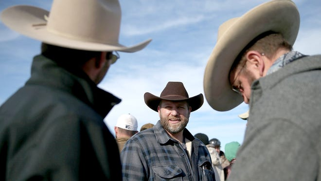 Ammon Bundy, the leader of an anti-government militia, talks with supporters in front of the Malheur National Wildlife Refuge Headquarters on Jan. 6, 2016, near Burns, Ore.  An armed anti-government militia group continues to occupy the Malheur National Wildlife Headquarters as they protest the jailing  of two ranchers for arson.