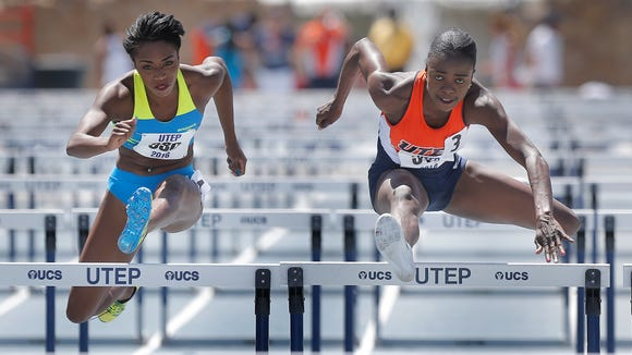 UTEP's Tobi Amusan, right, outruns Bridgette Owens to win the women's 100-meter hurdles Saturday at the University of Texas at El Paso Spring Invitational at Kidd Field. Amusan's time of 12.83 broke the school record, track record and is the fourth fastest time in the world this year. See more photos at elpasotimes.com.