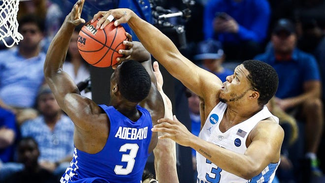University of North Carolina forward Kennedy Meeks (right) blocks the shot of University of Kentucky forward Edrice Adebayo (left) in their NCAA tournament Elite Eight matchup at the FedExForum.