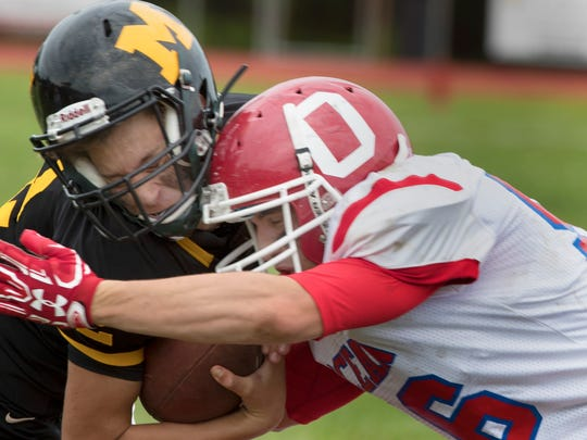 Monmouth Regiona;s Colin Miller takes a hard hit to