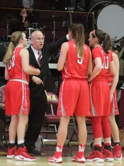 Marist head coach Brian Giorgis gives his players a pep talk during a college women's basketball game between Iona and Marist at the Hynes Center in New Rochelle on Sunday, January 15th, 2017. Marist won 68-62.